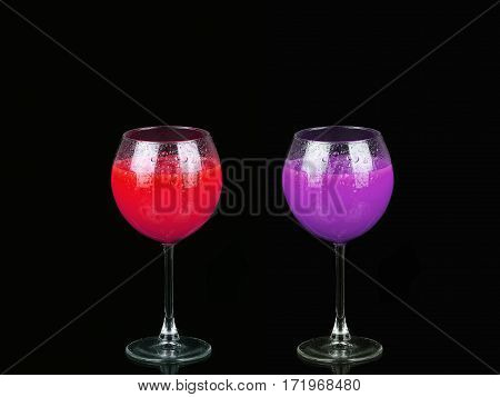Cosmopolitan Cocktail In Nice Red And Purple Colors In Front Of A Black Background
