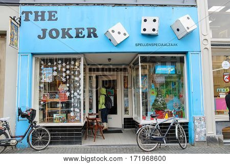 Utrecht the Netherlands - February 13 2016: Woman coming in to The Joker toys shop in city centre (Oudegracht)