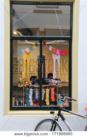 Utrecht the Netherlands - February 13 2016: Bike front of the window of children's clothing store Prinses en Erwtje (Hamburgerstraat)
