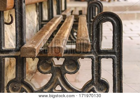 Old style bench with metal frame and wooden seat