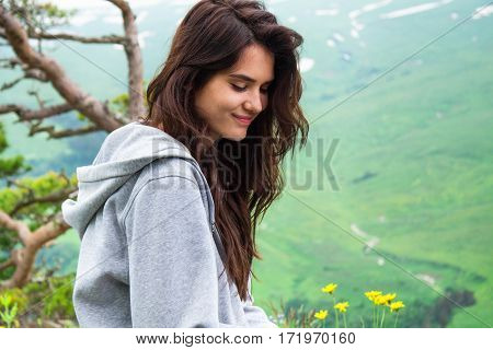 Portrait Pretty Hipster Woman Sitting On Mountain Top