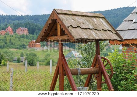 Old style wooden well in the village. Ukraine