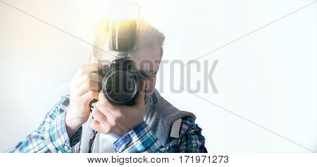 Hipster Guy With A Camera, The Photographer On A White Background, A Freelance Designer,