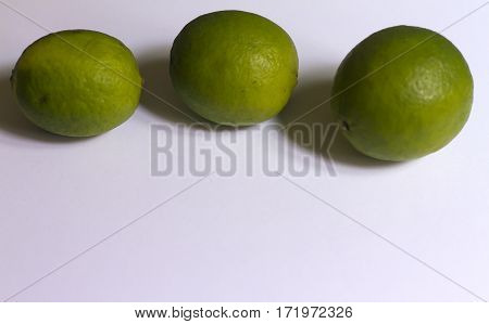 Beauty  greeen and acud limes  on neutral background