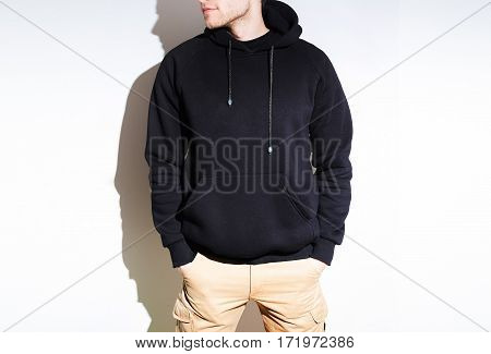 Man, Guy In Blank Black Hoodie, Sweatshirt, Mock Up Isolated. Plain Hoody Design Presentation.