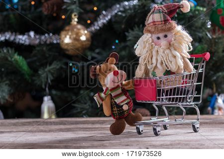 Happy Christmas characters pushing shopping cart. Christmas tree in background