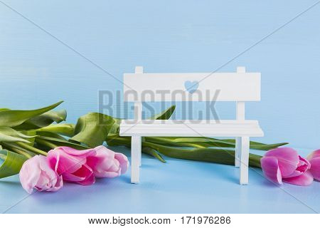 Bouquet Of Tender Pink Tulips With White Bench On Blue Wooden Background