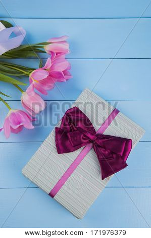 Bouquet Of Tender Pink Tulips With Gift Box On Blue Wooden Background