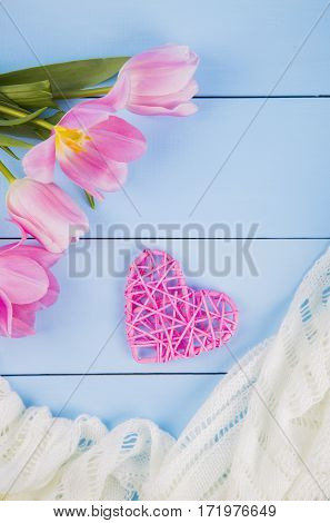 Bouquet Of Tender Pink Tulips With Heart And Fabric On Blue Wooden Background