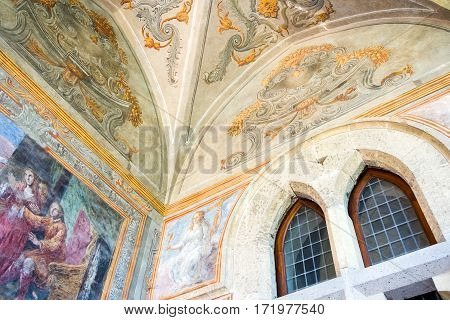 Naples Italy - March 14 2008: Sacred paintings in the Santa Chiara Monastery cloister