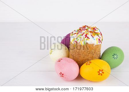 Easter Cake With Colorful Eggs On White Wooden Background