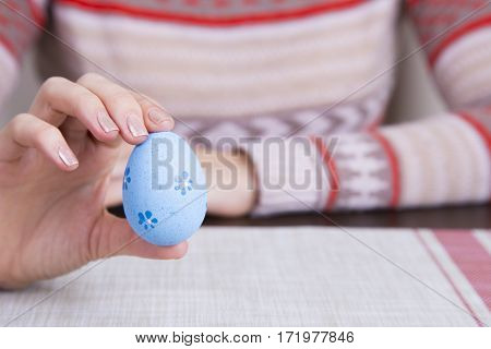 Blue Colored Easter Egg In Female Hands