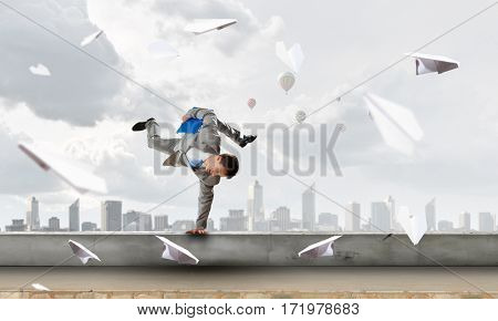 Young businessman breakdancer. Mixed media . Mixed media