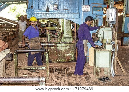 People Work At An An Old Furniture Carpenters Workshop With Old Machines