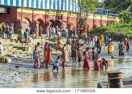 Hindu People Bath In The  Holy River Ganges