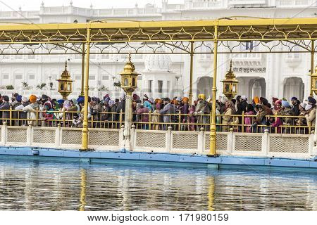 People Visit The   Harimandir Sahib At The Golden Temple Complex