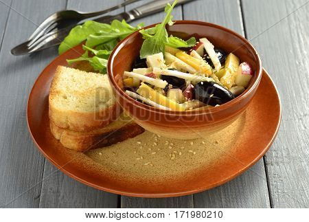 Cheese salad with grapes apple and celery served with toasted bread