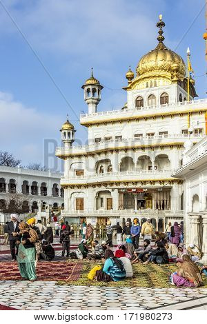 People Visit The  Harimandir Sahib At The Golden Temple Complex, Amritsar