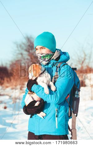 Boy Holding The Dog During  The Winter Trip