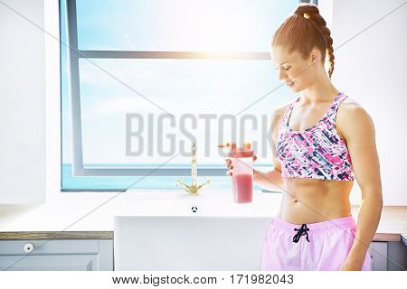 Woman At Kitchen With Glass Of Smoothie