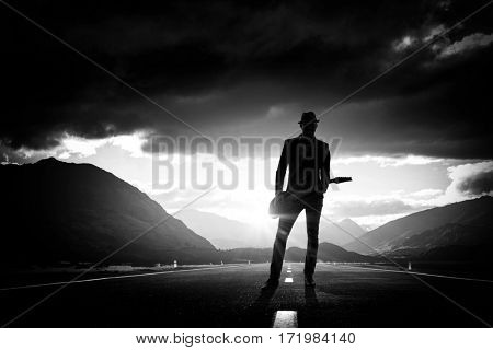 Elegant guitarist silhouette . Mixed media