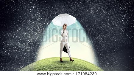 Businesswoman with white umbrella . Mixed media