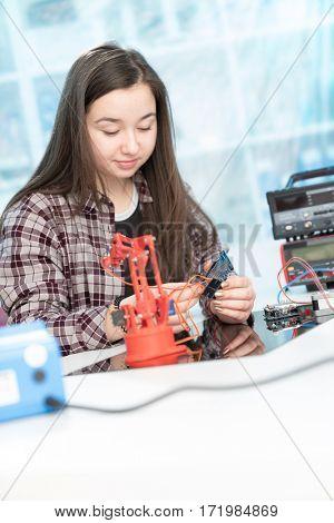 girl  in robotics laboratory
