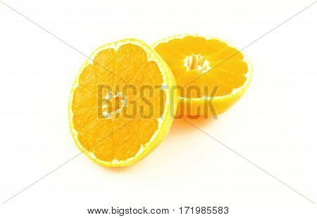 Two halfs of mandarin fruit on white background. Fresh and heath tropical citrus fruit.