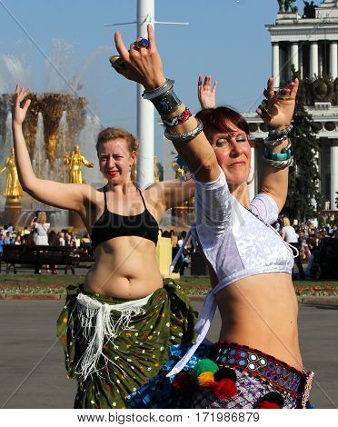 Moscow, Russia - May 18, 2014: Beautiful Women Dansing At Cosplay Festival On A Background Of The Fo