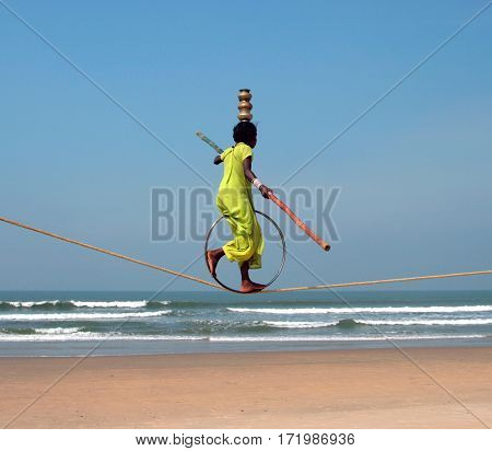 Goa, India - Feb 12: Wandering Indian Tightrope Walker Playing On The Beach Of Goa, On Feb 12, 2008.