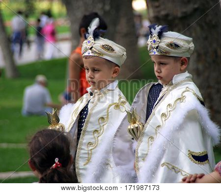 Istanbul, Turkey - Jun 15, 2008: Two Boys Dressed As Turkish Sultans In The Park Of Topkapi Palace,