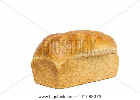 An unsliced loaf of honey wheat bread.
