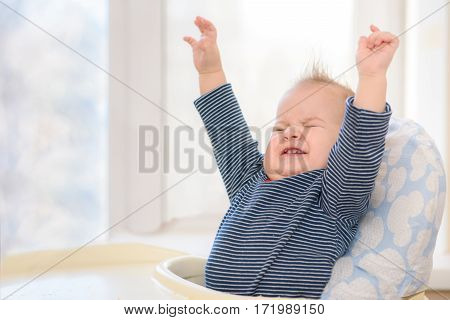 Cheerful Kid With Admiration His Hands Up