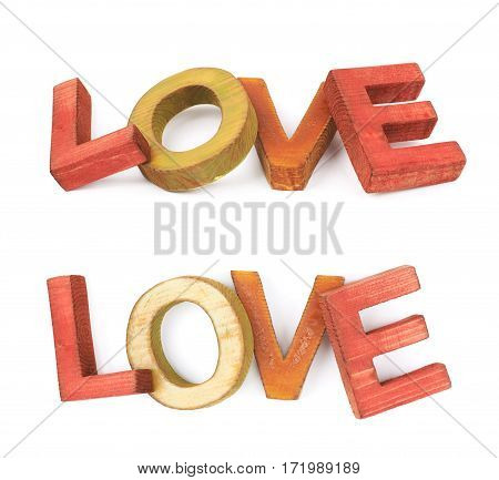 Word Love made of colored with paint wooden letters, composition isolated over the white background, set of two different foreshortenings