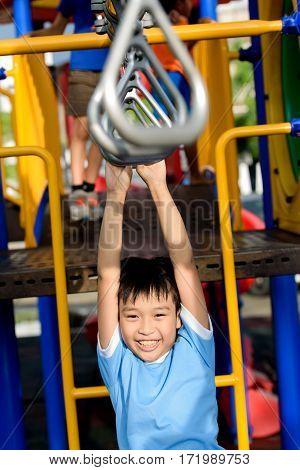 Young Asian Boy Hang The Bar