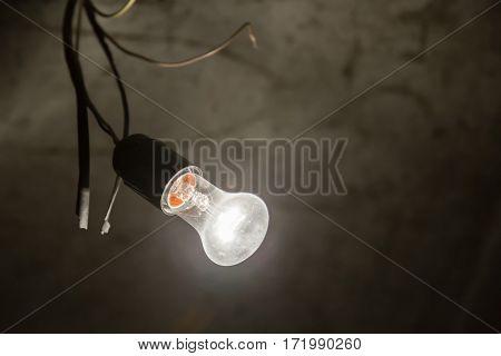 Light Bulb Illuminates A Dark Room.