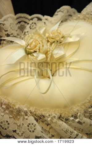 Wedding Rings Tied To Ribbons On Pillow