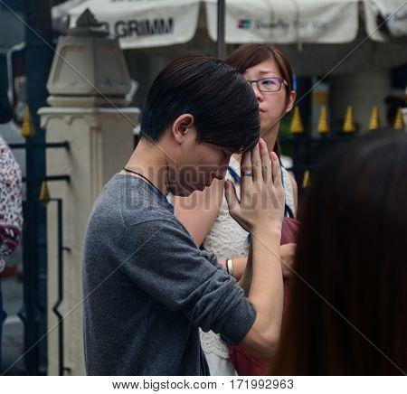 People Praying At Wat Erawan In Bangkok