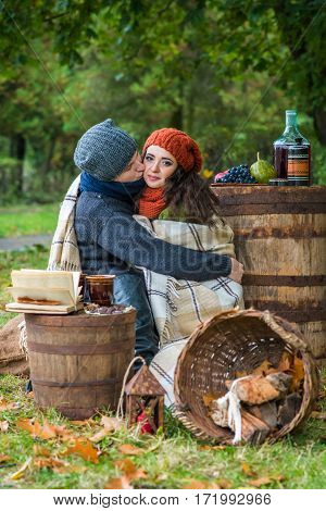 loving young couple sitting in the autumn garden