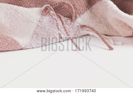 a warm beige wool blanket in the Scottish cage with copy Space and white background