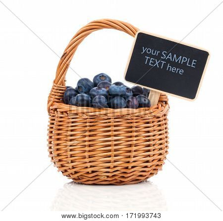 Bilberry in a basket to the board for text on a white background