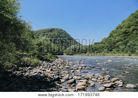 cold mountain blue river flowing past rocks