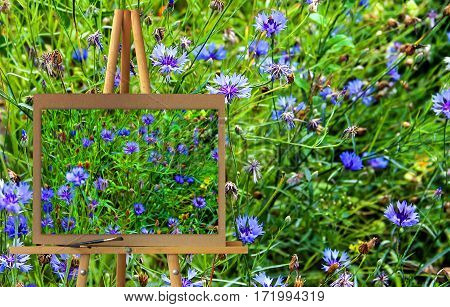 Easel With A Painting Watercolor Illustration Of Variegated Flower Bed In The Early Morning Photo Ma