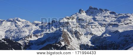 Gross Charpf and other mountains in Glarus Canton winter scene. View from Braunwald.