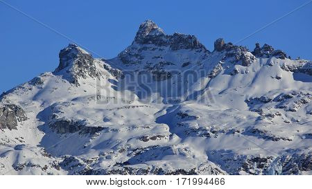 Snow covered mountain Gross Charpf. Mountain in Glarus Canton. View from Braunwald.