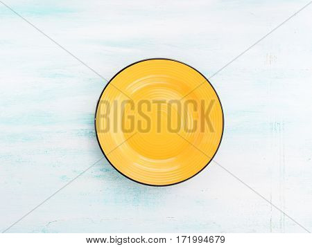 Pastel Color yellow ceramic plate dish top view background