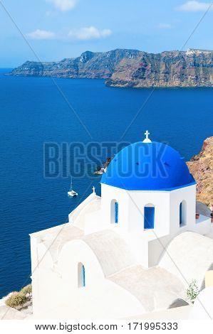 Church With Blue Domes In Santorini Island, Greece