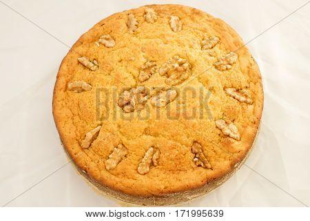 top vie of a vanilla sponge cake with walnuts