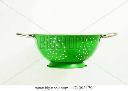 Old a green metal a colander sieve