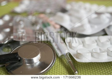 medical treatment for flu with pills and stethoscope